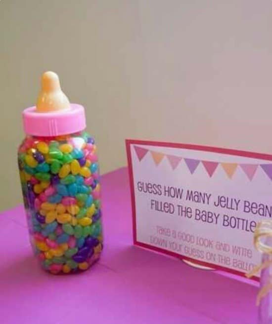 Guess How Many Jelly Beans in the Baby Bottle Game, 15 Entertaining Baby Shower Games via Pretty My Party