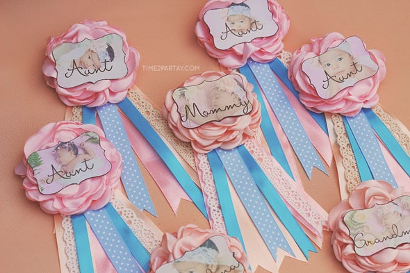 ribbon pins were made for all of the guests to wear during the party