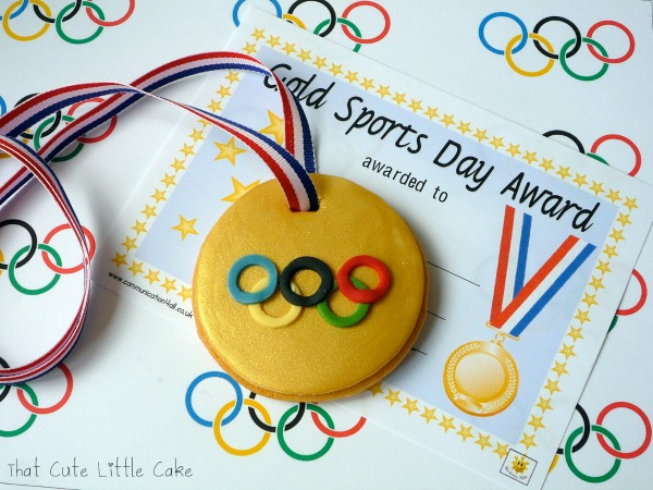Olympic Gold Medal Cookie, 13 Creative Olympic Party Ideas via Pretty My Party