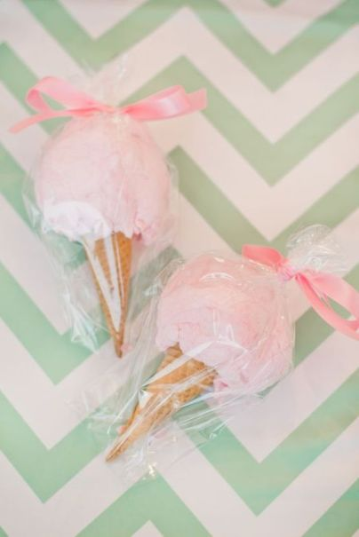 Pink cotton candy cone party favors with pink bows