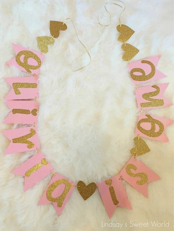A pink and gold birthday banner