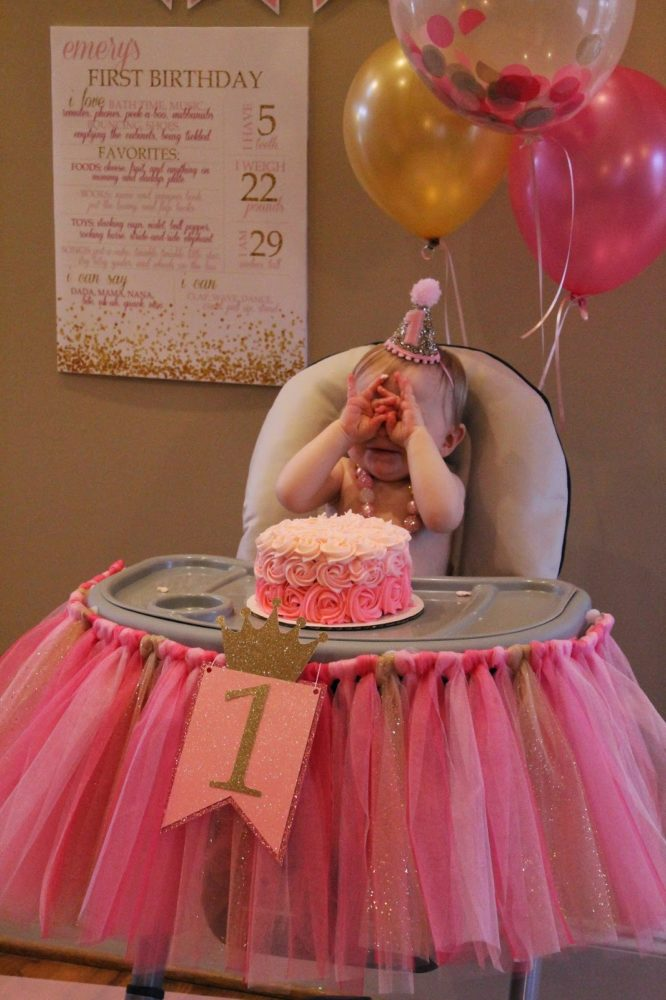 Pink and gold high chair idea for a first birthday party.