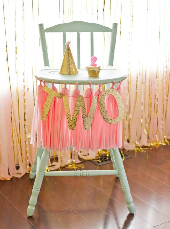 Pink and Gold First Birthday High Chair Decor via Pretty My Party