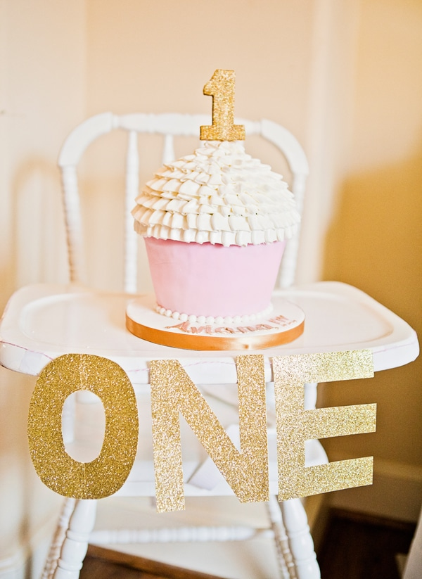 A pink and gold first birthday smash cake idea.