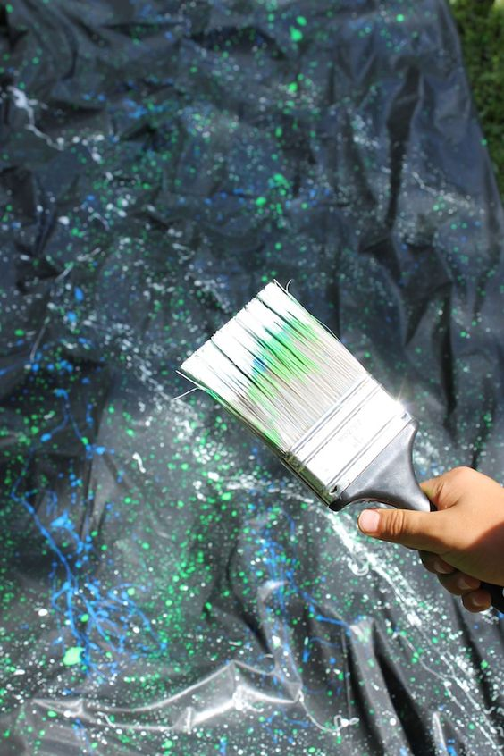 DIY Glow in the Dark Paint Splatter Table Cover | Pretty My Party