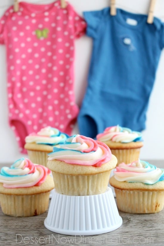 Gender reveal party cupcakes in pink and blue.