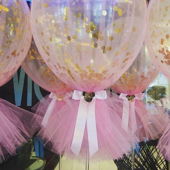 Gold and pink polka dot balloons.