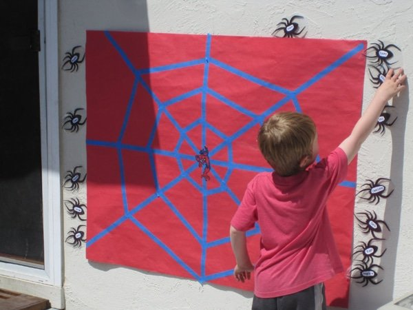 +12 Spider-man Party Ideas Mom's little hero has grown another year and it's just the chance to have a wonderful party with a theme that kids adore, the amazing Spider-man. Prepare the mothers throw nets and spider sense so that all the guests have incredible moments and organize an unforgettable children's party. www.partymazing.com Spiderman Pin the Spider on the Web Party Game Idea