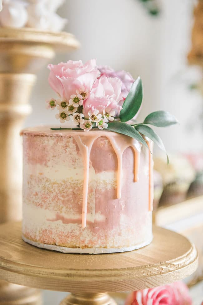 Blush Pink Drip Cake with Flowers for Garden Themed Birthday Party