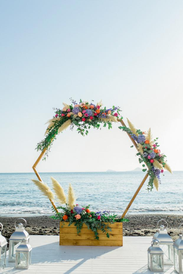 Beach wedding floral circle ceremony backdrop