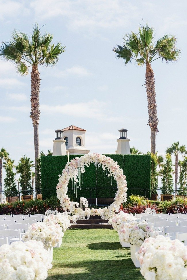 Glam white floral circle ceremony arch