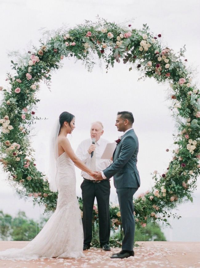 Gigantic circle wedding ceremony backdrop with flowers
