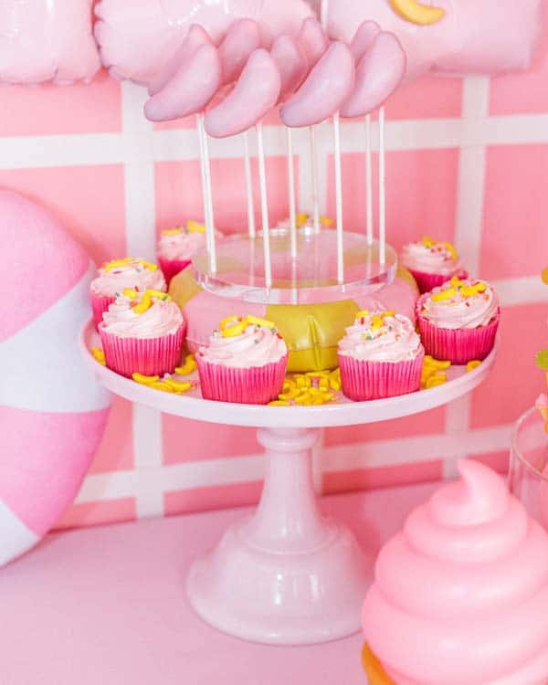 Banana Cake Pops and Pink Cupcakes With Banana Candies and Sprinkles